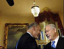 Sen. Charles Schumer (D-N.Y.) greets Israeli Prime Minister Binyamin Netanyahu, right, on Capitol Hill