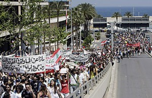 Lebanese take part in a rally calling for Secularism in downtown Beirut on April 25, 2010. Thousands of Lebanese marched to parliament in Beirut in a peaceful rally demanding the secularisation of a state long built on sectarianism