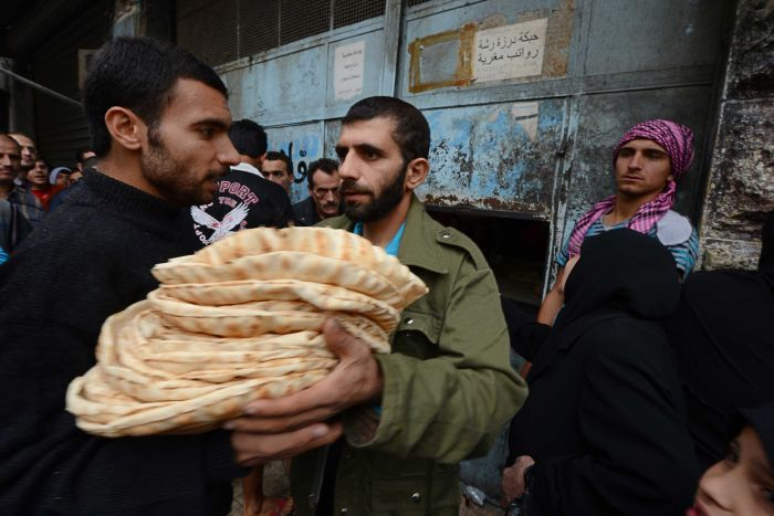 syria truce citizen w bread