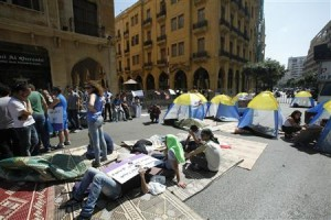 Protesters stage a sit-in demonstration against the postponement of June's parliamentary election until next year, near the parliament building in Beirut