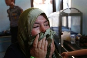 Nadine Bakour, a Lebanese woman who lost her husband and two sons in the accident, cries in a health clinic.