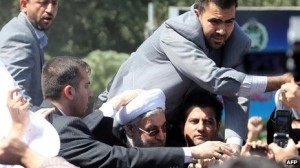 Rouhani met w cheers protests
