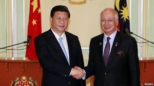 China's President Xi Jinping (L) and Malaysia's Prime Minister Najib Razak