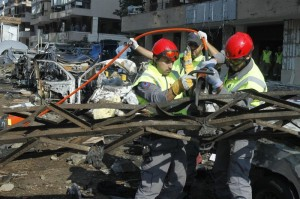 Hezbollah civil defense members work at the site of the two suicide bombings that occurred on Tuesday near Iran's embassy compound in Beirut