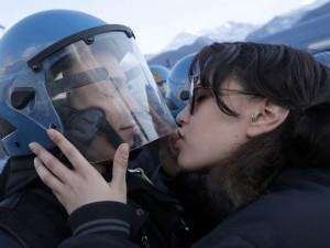 Italian protester kises police