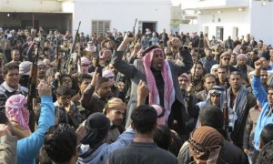 Residents gather to protest near the house of Alwani, in Ramadi