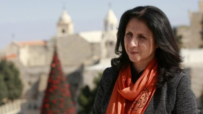 """Bethlehem's first female mayor, Vera Baboun is seen in front of the Church of Nativity, traditionally believed by Christians to be the birthplace of Jesus Christ, in the West bank city of Bethlehem. Bethlehem's first female mayor, Vera Baboun, can't walk through the main square of the biblical town without being stopped by admirers. """"This is our new mayor, who is turning Bethlehem into one of the greatest cities in the world,"""" a tour guide hollered to a group of Christian tourists passing by the Church of the Nativity"""