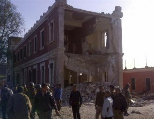 People and army personnel stand around a damaged bulding after an explosion in Egypt's Nile Delta town of Anshas, about 100 km (65 miles) northeast of Cairo
