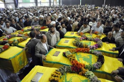 Funeral of Hezbollah fighters killed in Syria. Iran is now recruiting  Shitte refugees from Afghanistan  to fight the Sunni rebels  in Syria and reduce the  mounting casualties  f Hezbollah fighters