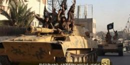 An image made available by Jihadist media outlet Welayat Raqa on Jun 30, 2014, allegedly shows a member of the IS (Islamic state) militant group parading with a tank in a street in the northern rebel-held Syrian city of Raqa.
