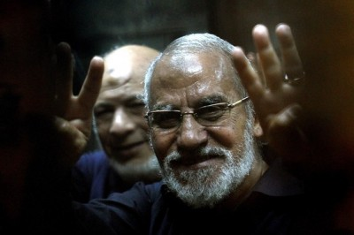 "The Muslim Brotherhood's supreme guide, Mohamed Badie, flashing the ""Rabaa"" sign, which means four in Arabic, remembering those killed in the crackdown on the Rabaa al-Adawiya protest camp in Cairo last year, on May 8."