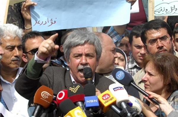 SCC chief Hanna Gharib (C)