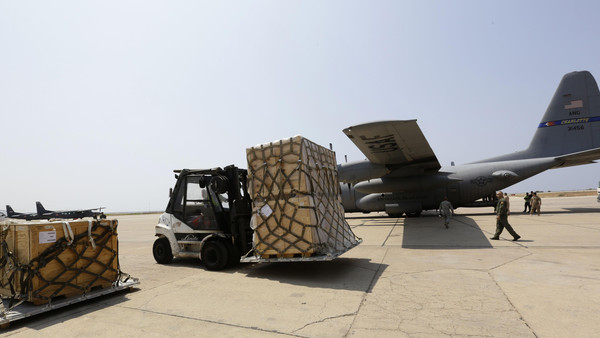 A forklift moves a shipment of weapons that was delivered by a US air force plane on August 29, 2014 at a Lebanese military base at Beirut International Airport. The United States is supplying Lebanon's army with additional munitions and ordnance in a bid to bolster the force after clashes with jihadists in the eastern Arsal region of the country, on the Syrian border. AFP PHOTO/ANWAR AMRO