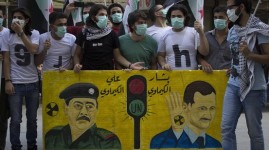A protest on the first anniversary of the chemical massacre in East Ghota in which hundreds of civilians were killed. August 21, 2014  Zuma Press
