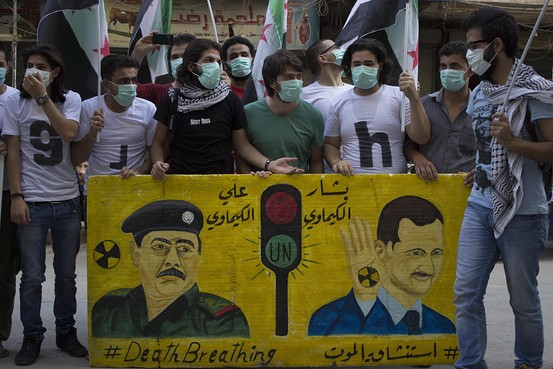 A protest on the first anniversary of the chemical massacre in East Ghota in which hundreds of civilians were killed. August 21. Zuma Press