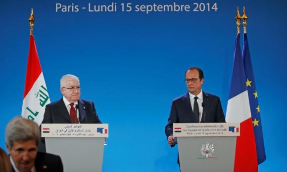 French President Francois Hollande (R), Iraq's President Fuad Masum and U.S. Secretary of State John Kerry  (front, L) arrive to attend the opening of an international conference bringing together about 30 countries to discuss how to cooperate in the fight against Islamic State militants in Paris September 15, 2014.  REUTERS/Christian Hartmann