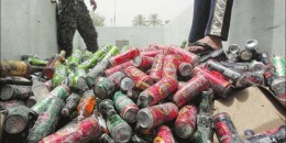 An Iraqi throws beer cans in a pile from a liquor store that was targeted in a car bomb attack that destroyed 11 liquor stores in Baghdad in 2011. While Islam prohibits alcohol, Baghdad has had a flourishing drinking scene in the past. Photograph by: Ahmad Al-Rubaye, Getty Images , Bloomberg