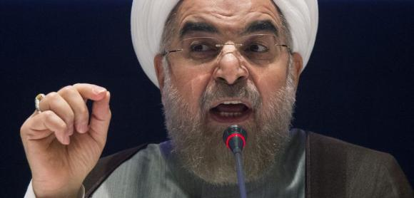 IIranian President Hassan Rouhani ran for office as a moderate, but has been unable or unwilling to stem the persecution of Christians and other religious minorities, according to a UN report. (AP)