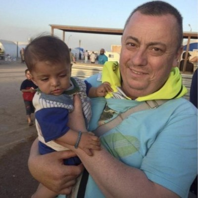 An undated family handout photo of British aid worker Alan Henning taken at a refugee camp on the Turkish-Syria border. REUTERS/Henning family handout via the British Foreign and Commonwealth Office/Handout via Reuters