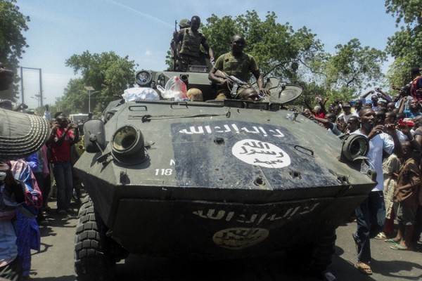 Nigerian soldiers display one of the captured Boko Haram armoured vehicles last September [EPA]
