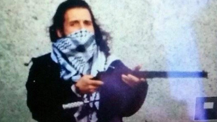 MICHAEL ZEHAF-BIBEAU, PICTURED IN THIS IMAGE TWEETED FROM AN ISIS ACCOUNT, HAS BEEN IDENTIFIED AS THE SHOOTER OF A SOLDIER STANDING GUARD AT THE NATIONAL WAR MEMORIAL IN OTTAWA ON WEDNESDAY OCT. 22, 2014