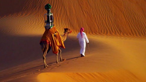 A man guides a camel bearing a 360-degree Google Street View camera through the Liwa desert in the United Arab Emirates in the video,