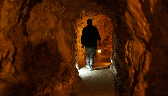 A man in Mleeta , south Lebanon walks in a tunnel in an underground bunker at the Resistance Museum, a showcase built by Hezbollah, Nov. 14, 2013. (photo by Spencer Platt/Getty Images)