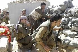 Kurdish peshmerga  troops on Wednesday were surrounding a clinic in Rabia where several Islamic State jihadists had holed up after their group lost control of the town