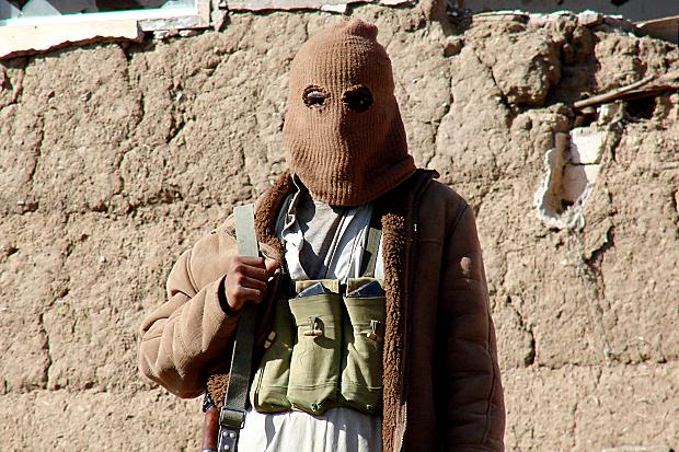 Masked Yemeni houthi rebel . Yemeni President Abed Rabbu Mansour Hadi had repeatedly accused Iran and its proxy Hezbollah of aiding and training the Houthi rebels