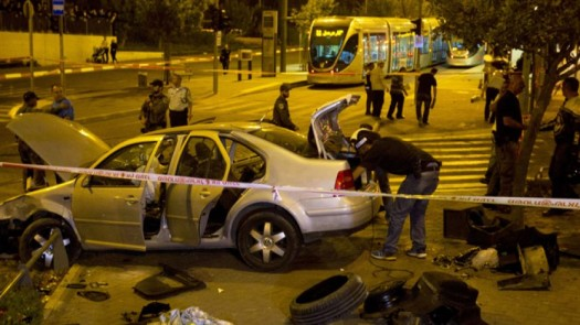 Oct. 22, 2014: Israeli police officers inspect a car at the scene of an attack in Jerusalem. A Palestinian motorist with a history of anti-Israel violence slammed his car into a crowded train station in Jerusalem on Wednesday, killing a three-month-old baby girl and wounding several people in what police called a terror attack. (AP)