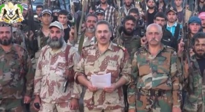Colonel Abduall Rifai shown reading a statement  during the formation of a military faction in Qalamoun  near Damascus
