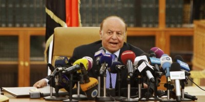 Yemen's President Abd-Rabbu Mansour Hadi speaks as he holds an agreement (L) signed between the government and Houthi rebels, in Sanaa September 21, 2014. REUTERS/Mohamed al-Sayaghi