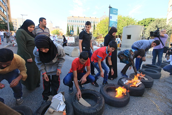 Relatives of Lebanese soldiers fire tires during the protest in front of government building in Beirut, Lebanon, on October 22, 2014. Lebanese soldiers kidnapped by Islamic State of Iraq and Levant (ISIL) and Jabhat al-Nusra three months ago. (Photo by Ratib Al Safadi7Anadolu Agency/Getty Images)
