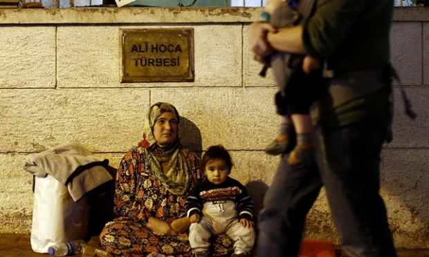 A Syrian refugee begs with her child in Istanbul. Photograph: Sedat Suna /EPA