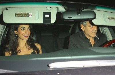 George and Amal were all smiles after enjoying a dinner date at Craig's Restaurant in Hollywood, California on Saturday. (Image: Daily Mail)