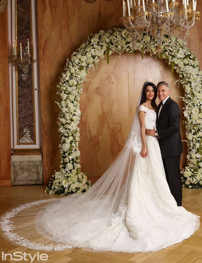 The bride dazzled in a custom-made Oscar de la Renta wedding gown crafted of French lace. Amal's dress featured a floor-brushing train with hand-embroidered pearls and diamanté accents. The designer loved it so much that he added a similar dress to his fall 2015 bridal collection.