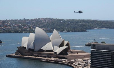 A police helicopter hovers over the Opera House after the building was evacuated. Photograph: ABC