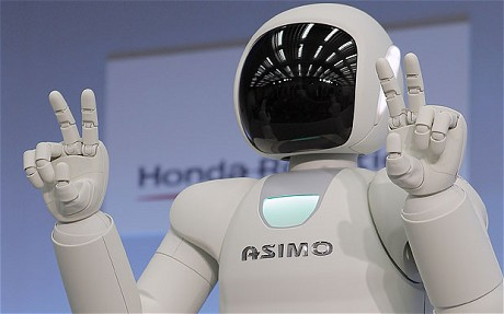 "Human-shaped robot ""Asimo""  by Honda uses Japanese sign language . Can take a drinks order, open a thermos flask, and pour out a juice .Photo: AP"