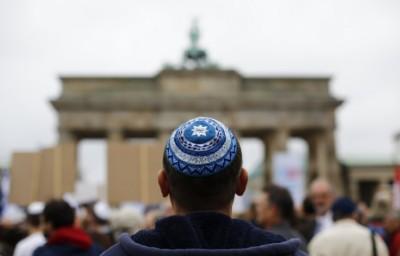 A man wearing a kippah waits for the start of an anti-Semitism demo at Berlin's Brandenburg Gate in September(Reuters)