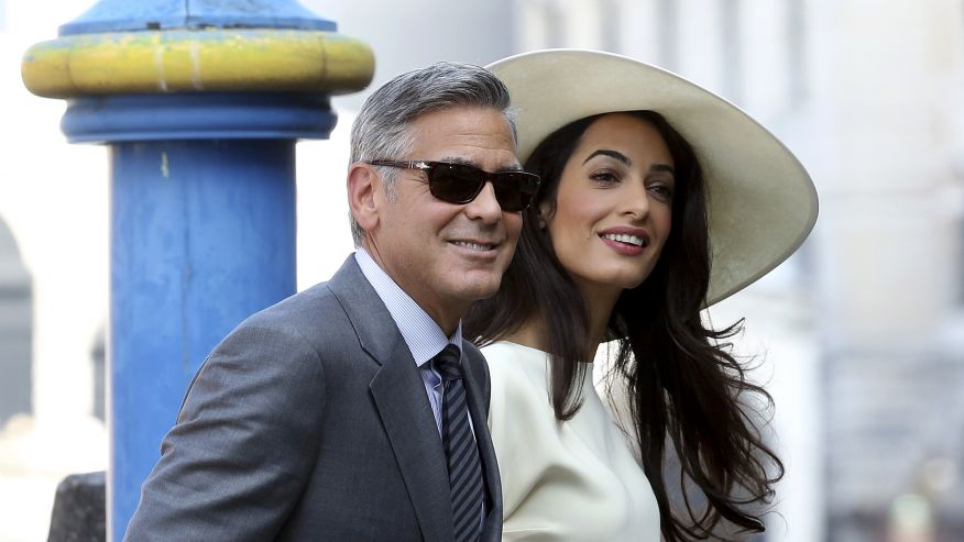 george clooney and amal in white in venice