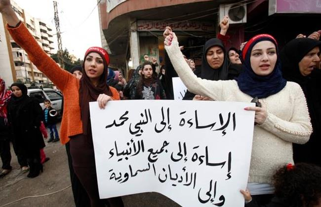 Protesters in Sidon , south Lebanon denounce the French satirical magazine Charlie Hebdo over it most recent issue showing the Muslim Prophet Mohammad on its cover.