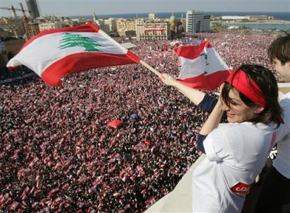 On March 14, 2005, a month after former PM Rafik Hariri's assassination , over a million Lebanese flocked to downtown Beirut to demand the withdrawal of Syrian troops from Lebanon after a nearly 29-year of military presence. The mass rally was later dubbed the Cedar Revolution or Independence Uprising.