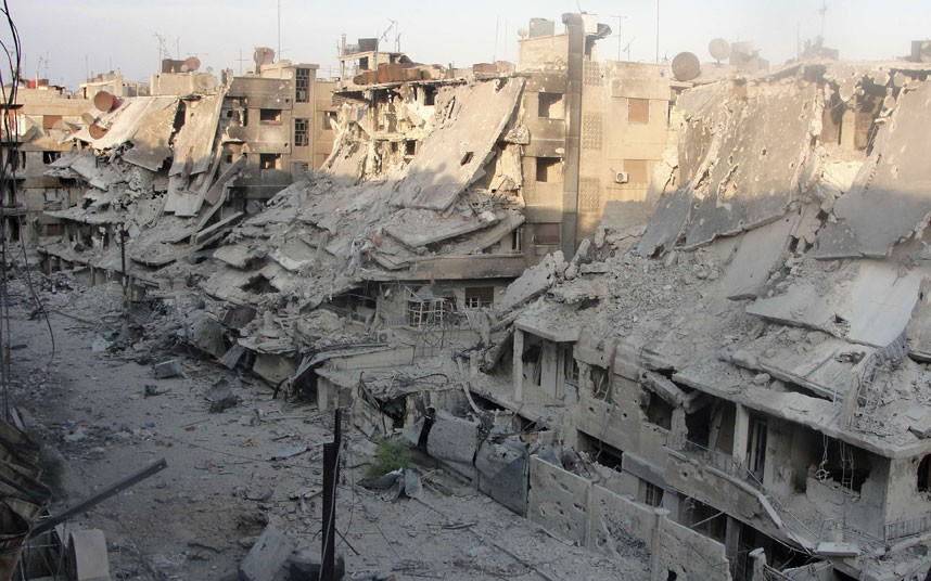 Destroyed buildings in Syria's besieged central city of Homs , following shelling  by the  government forces  on October 7, 2012.