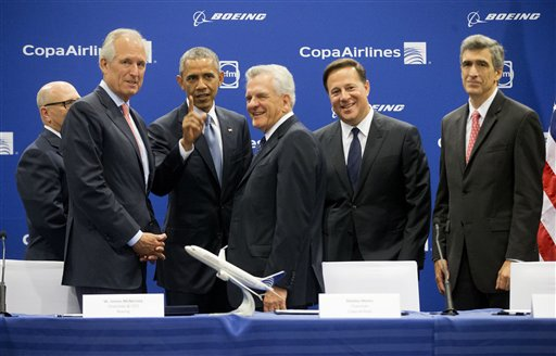 President Barack Obama, and Panamanian President Juan Carlos Varela, talk with, from left, GE Aviation President and CEO David Joyce, Boeing Chairman and CEO Jim McNerney, Copa Chairman Stanley Motta, and Copa CEO Pedro Heilbron, after they signed an airplane order between Copa Airlines and Boeing, announcing plans for the Panamanian airlines to purchase 61 of the US airplane giant 737 aircraft, Friday, April 10, 2015, during a ceremony in Panama City, Panama. (AP Photo/Pablo Martinez Monsivais)
