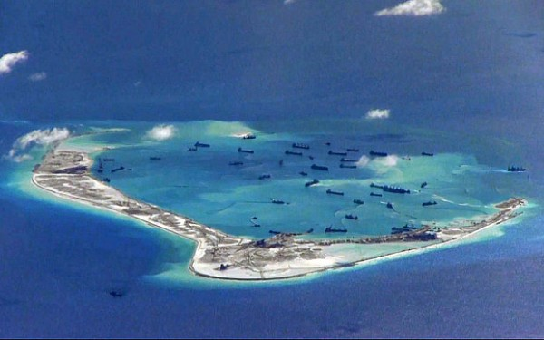 Chinese dredging vessels in the waters around Mischief Reef