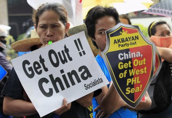 Protesters make noise during a rally regarding the disputed islands in the South China Sea, in front of the Chinese Consulate in Makati city, metro Manila July 24, 2015. REUTERS/Romeo Ranoco