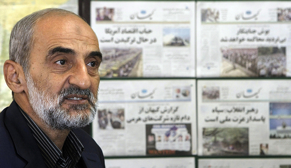 Hossein Shariatmadari, editor-in-chief of the hard-line Kayhan newspaper group for more than two decades, sits next to issues of the newspaper at his office in Tehran, Sept. 16, 2007.  (photo by Getty Images/Behrouz Mehri) Read more: http://www.al-monitor.com/pulse/originals/2015/06/iran-us-nuclear-deal-great-satan.html#ixzz3iya73sGQ