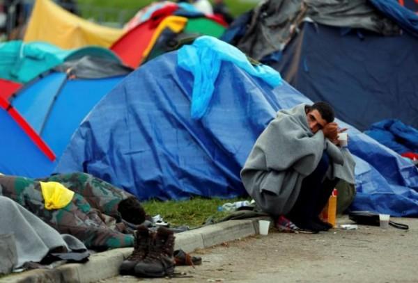 A migrant sits beside tents at the Croatia-Slovenia border crossing at Bregana, Croatia, September 20, 2015.       REUTERS/Laszlo Balogh