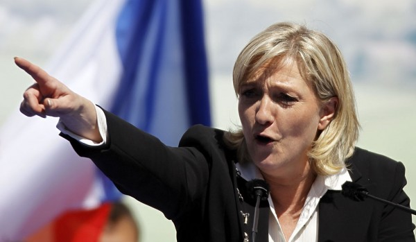 """Marine Le Pen,  the French far-right leader  accused Germany   of looking to lower wages and hire """"slaves"""" by opening its doors to thousands of migrants and refugees."""