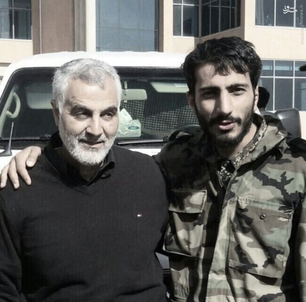 Qassem Suleimani , the head of Iran's Revolutionary Guards elite the Quds Force is shown with Mostafa Sadrzadeh , who is the top Iranian commander of the Fatemiyoun Brigade which is formed of Iran-based Afghan expatriates who are trained by Tehran to fight in Syria